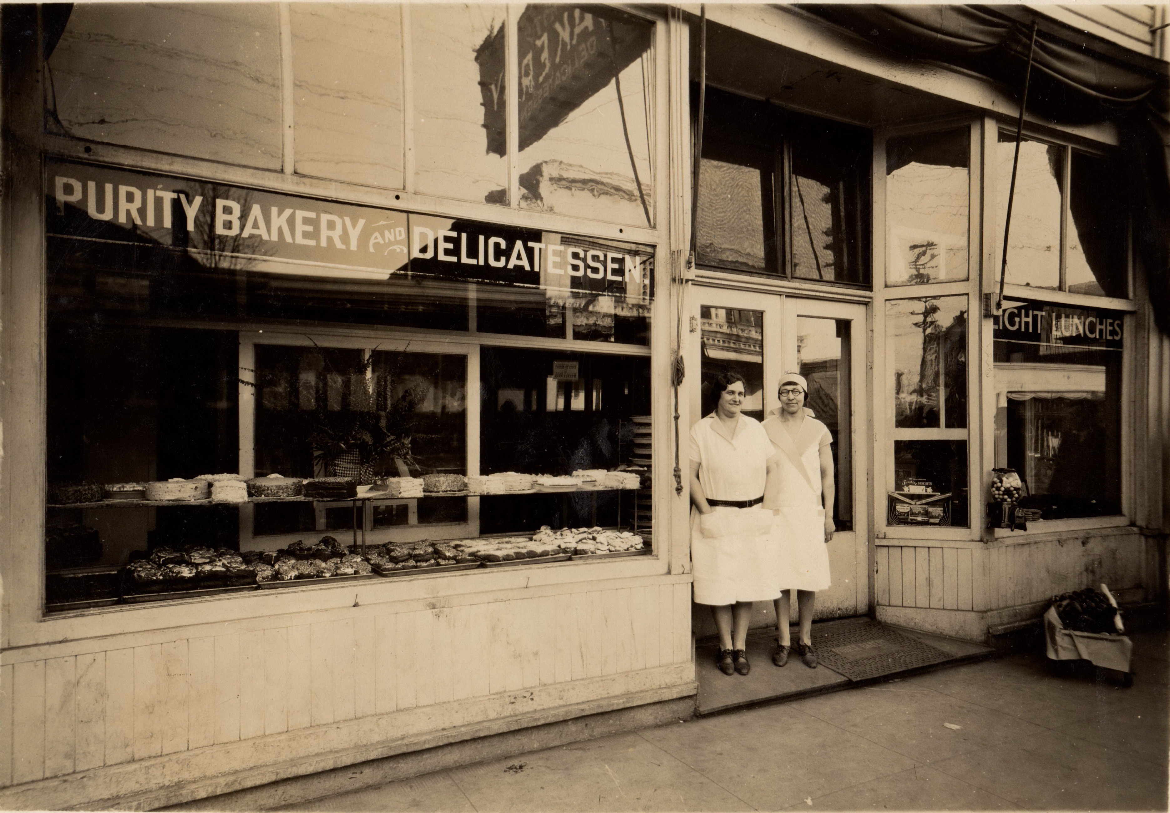 On Jersey street (Lombard) Owner Alex Giese Mrs Giese on left 1927 Thomas Coupe ran the Purity Bakery on North Jersey until 1921.
