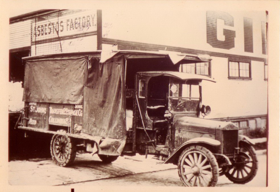 St Johns Laundry truck in front of Gillen-Chambers Asbestos Co.