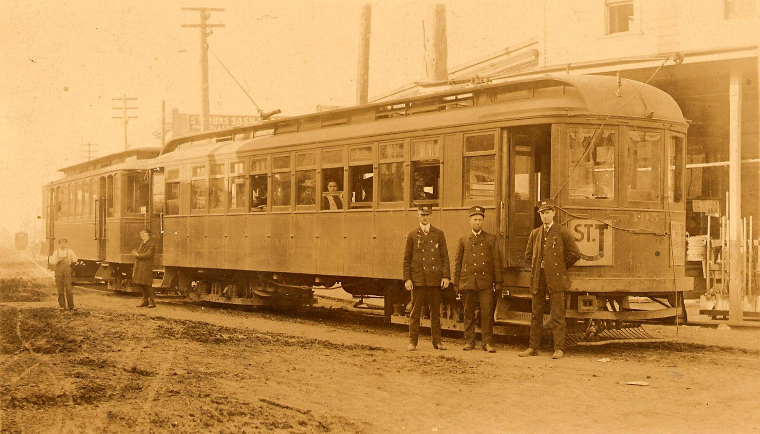car 195 in front of St Johns hardware.