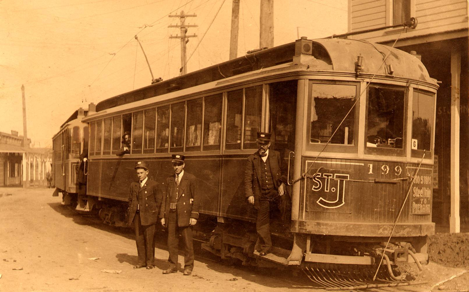 car 199 in front of St Johns Hardware